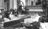 Workers operating Paper Cutter #2 at the Everett Pulp and Paper Company (the Lowell Paper Mill)