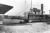 "Oscar Carlson Exhibit photo showing a side view of the ""Verona"" at the Everett City..."