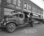 Hogland Transfer Inc. delivery truck carrying pipe for Everett pipe line #3
