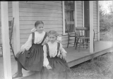 2 young girls on porch