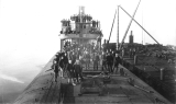 Citizens abord the whaleback barge C. W. Wetmore at the nailworks dock, Everett, Washington