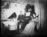 Family in parlor with organ and gramophone