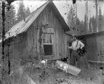 Rusic cabin and man with fish