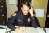 Police Officer at Desk